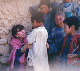 Roberta Gately Examining a Child